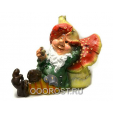 Садовая фигура Гном лежит на грибе h 61 см
